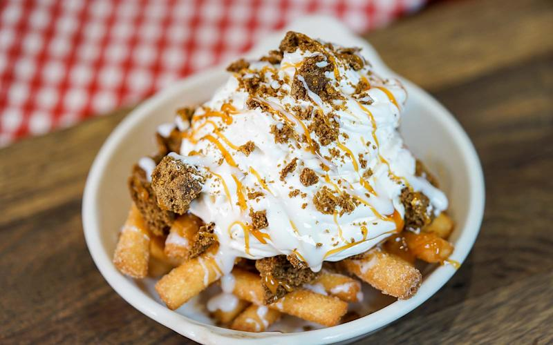 Gingerbread funnel cake fries served with whipped cream and candy crumbles.