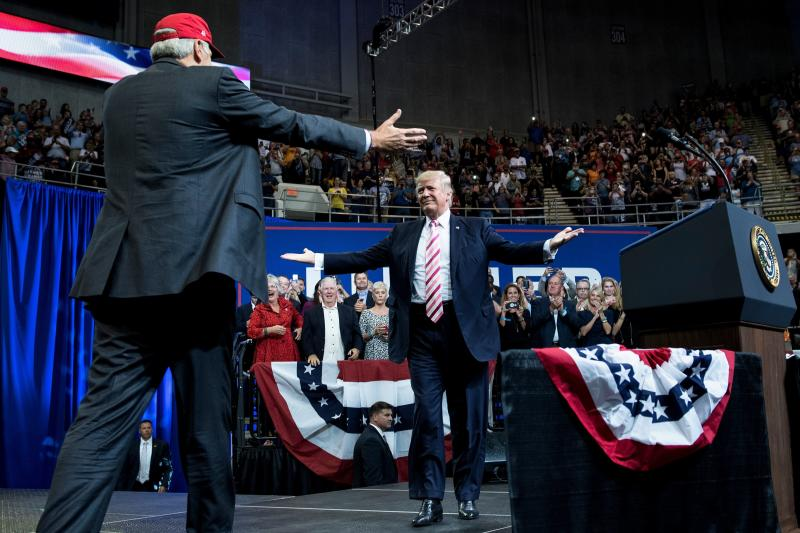 President Donald Trump prepares to embrace Sen. Luther Strange at a Sept. 22 rally in Huntsville, Alabama.  (BRENDAN SMIALOWSKI via Getty Images)