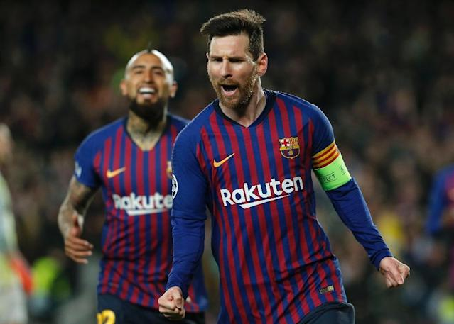 Lionel Messi scored twice, including a penalty, and set up two more goals as Barcelona beat Lyon 5-1 to march on to the Champions League quarter-finals (AFP Photo/PAU BARRENA)