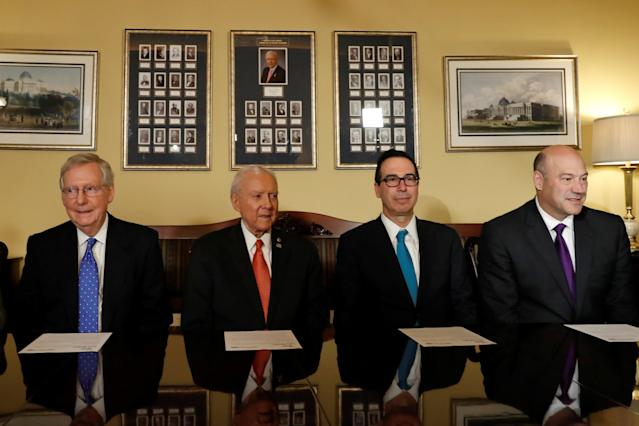 Senate Majority Leader Mitch McConnell, Sen. Orrin Hatch, Treasury Secretary Steve Mnuchin and National Economic Council Director Gary Cohn introduce the Republican tax reform plan at the Capitol on Nov. 9.  (Aaron Bernstein / Reuters)