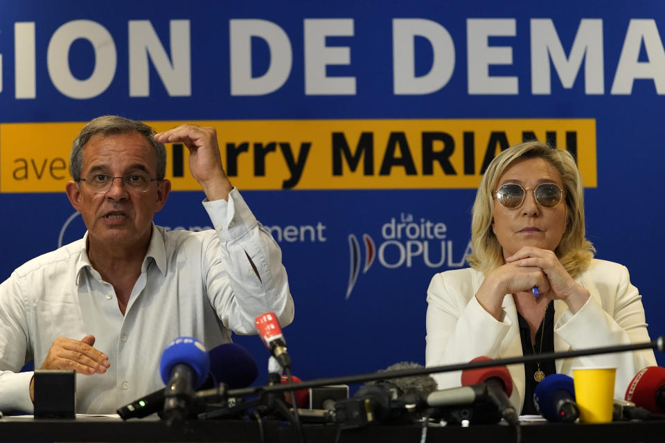 FILE - In this June 17, 2021, file photo, far-right leader Marine le Pen, right, and local candidate Thierry Mariani hold a press conference in Toulon, southern France. Le Pen's once-ascendant far-right party is struggling ahead of runoff elections for France's regional leadership. Its best chance of victory is Mariani, a European lawmaker who meets regularly with Syrian dictator Bashar al-Assad and celebrated Russia's annexation of Crimea. (AP Photo/Daniel Cole, File)