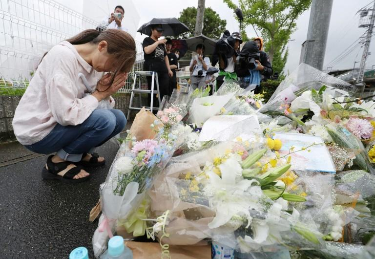 People continued to pay tribute to the victims on Saturday, leaving flowers