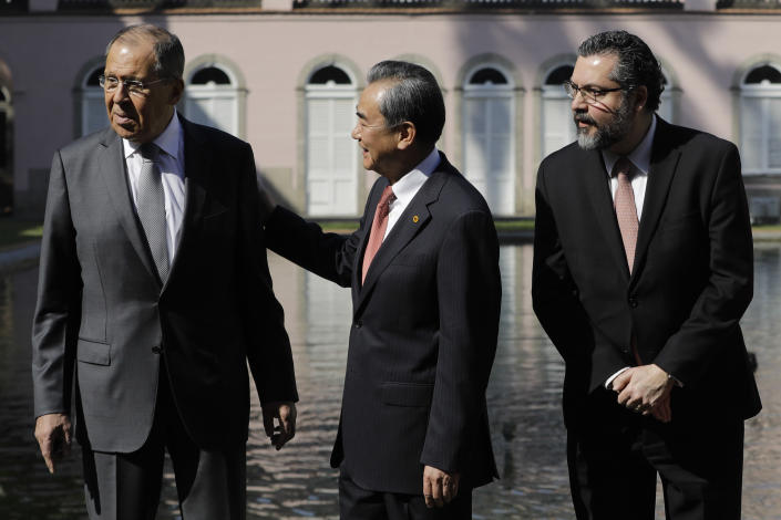 Russia's Foreign Minister Sergey Lavrov, from left, China's Foreign Minister Wang Yi and Brazil's Foreign Minister Ernesto Araujo, gather for a group photo during a BRICS representatives meeting in Rio de Janeiro, Brazil, Friday, July 26, 2019. A conservative Brazilian government that has expressed wariness of China and Russia is hosting foreign ministers of those nations as well as India and South Africa, keeping alive BRICS, an informal trade group launched under earlier leftist leaders. The delegations from the BRICS nations begin meeting Friday to pave the way for a summit in November. (AP Photo/Leo Correa)