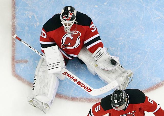 NEWARK, NJ - APRIL 13: Martin Brodeur #30 of the New Jersey Devils makes the third period save against the Boston Bruins at the Prudential Center on April 13, 2014 in Newark, New Jersey. The Devils defeated the Bruins 3-2. (Photo by Bruce Bennett/Getty Images)