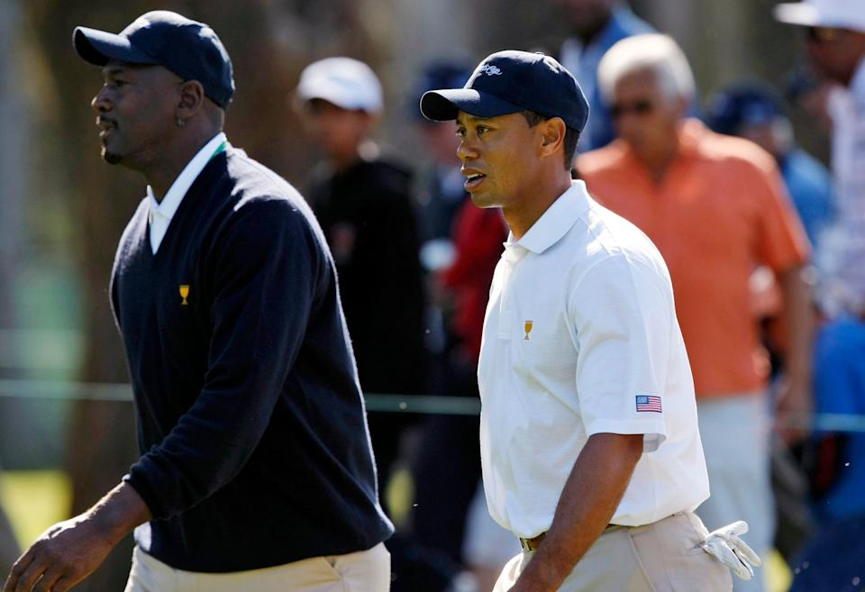 United States Presidents Cup team member Tiger Woods, right, walks with U.S. captain's assistant Michael Jordan during a practice round for the Presidents Cup golf competition Tuesday, Oct. 6, 2009, in San Francisco. (AP Photo/Marcio Jose Sanchez)