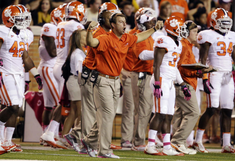 Clemson head coach Dabo Swinney directs his team against Wake Forest during the first half of an NCAA college football game in Winston-Salem, N.C., Thursday, Oct. 25, 2012. (AP Photo/Chuck Burton)