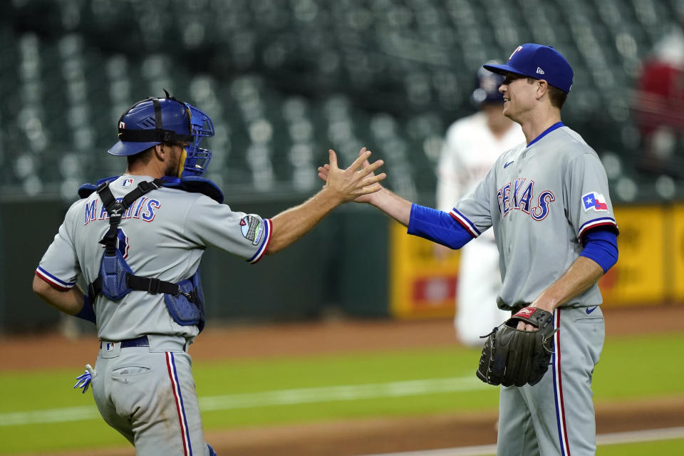 Texas Rangers starting pitcher Kyle Gibson, right, celebrates with catcher Jeff Mathis after a baseball game against the Houston Astros Wednesday, Sept. 16, 2020, in Houston. The Rangers won 1-0. (AP Photo/David J. Phillip)
