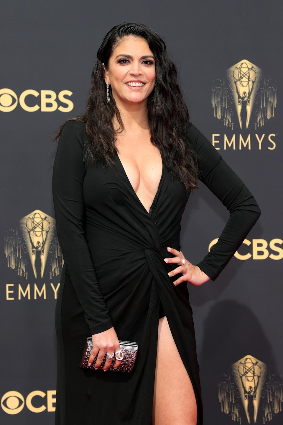 """<p><em>Saturday Night Live </em>star Cecily Strong may joke around for a living on the small screen, but she's certainly not playing with us at the 2021 Emmys. Makeup artist <a href=""""https://www.instagram.com/theamyclarke/"""" rel=""""nofollow noopener"""" target=""""_blank"""" data-ylk=""""slk:Amy Clarke"""" class=""""link rapid-noclick-resp"""">Amy Clarke</a> gave the star soft glam accompanied by fluttery lashes, while hairstylist <a href=""""https://www.instagram.com/paulnortonhair/"""" rel=""""nofollow noopener"""" target=""""_blank"""" data-ylk=""""slk:Paul Norton"""" class=""""link rapid-noclick-resp"""">Paul Norton</a> created sultry waves with a deep side part. </p>"""