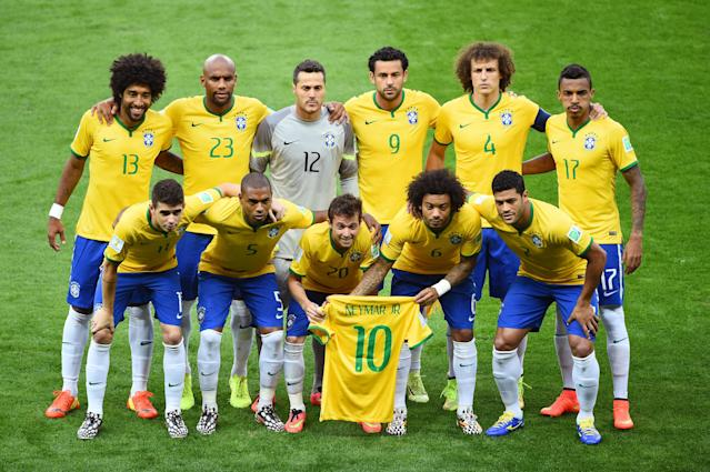 <p>The starting Brazil squad are pictured with the Neymar shirt ahead of the hosts' 7-1 semi-final thrashing at the hands of Germany. </p>