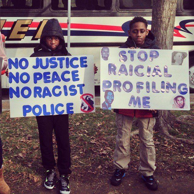 Young protesters hold signs in Freedom Plaza on Dec. 13, 2014.