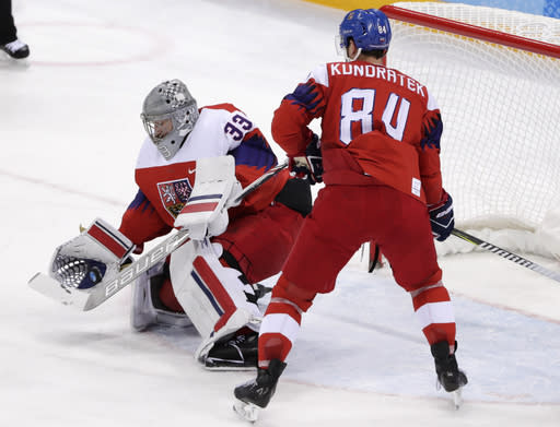 Goalie Pavel Francouz (33), of the Czech Republic, stops the puck during the first period of the semifinal round of the men's hockey game against the team from Russia at the 2018 Winter Olympics in Gangneung, South Korea, Friday, Feb. 23, 2018. (AP Photo/Frank Franklin II)