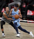 Brooklyn Nets guard Landry Shamet, left, defends against Memphis Grizzlies guard Ja Morant during the first half of an NBA basketball game Monday, Dec. 28, 2020, in New York. (AP Photo/Kathy Willens)