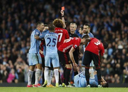 Britain Soccer Football - Manchester City v Manchester United - Premier League - Etihad Stadium - 27/4/17 Manchester United's Marouane Fellaini is shown a red card by referee Martin Atkinson Action Images via Reuters / Jason Cairnduff Livepic
