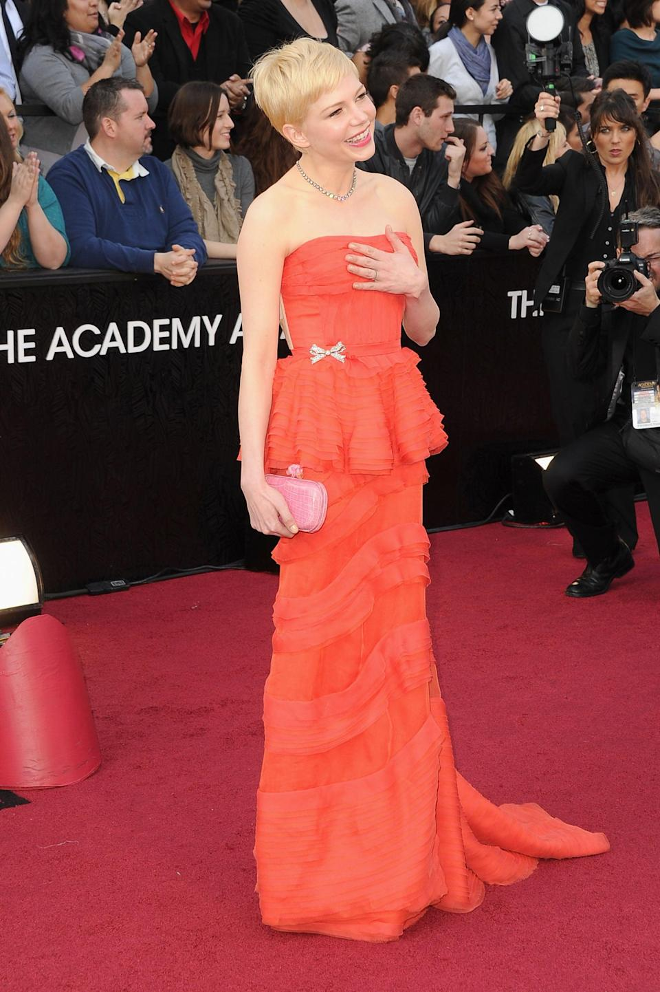 <p>The actress chose a strapless red lace gown by Louis Vuitton.</p>