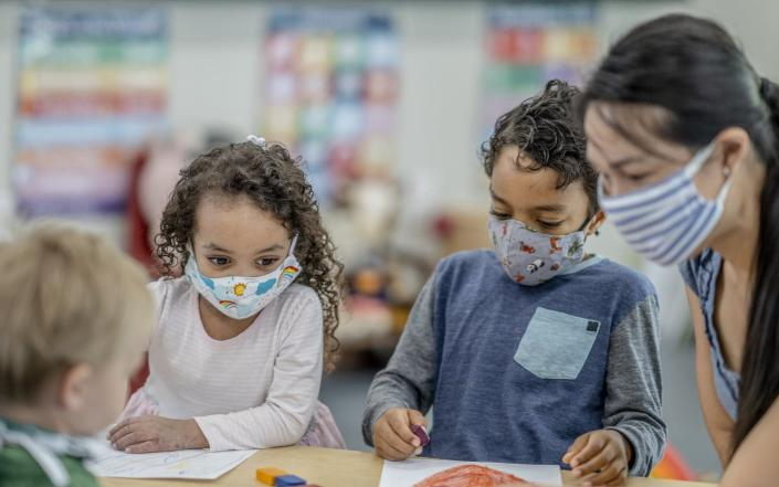 "<span class=""caption"">High-quality day care has always been scarce in the U.S.</span> <span class=""attribution""><a class=""link rapid-noclick-resp"" href=""https://www.gettyimages.com/detail/photo/group-of-children-colouring-while-wearing-masks-royalty-free-image/1263061836"" rel=""nofollow noopener"" target=""_blank"" data-ylk=""slk:FatCamera/E+ via Getty Images"">FatCamera/E+ via Getty Images</a></span>"