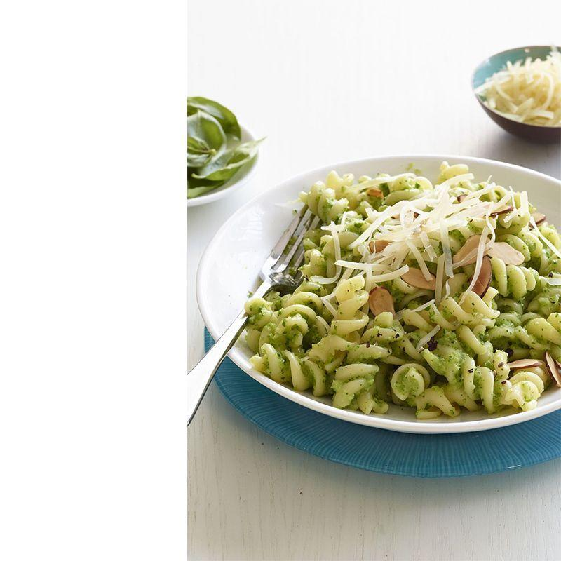 """<p>Vegetarians and meat-lovers alike will gravitate towards this flavorful dish topped with almonds and parmesan cheese.</p><p><a href=""""https://www.womansday.com/food-recipes/food-drinks/recipes/a12573/fusilli-broccoli-pesto-recipe-wdy0115/"""" rel=""""nofollow noopener"""" target=""""_blank"""" data-ylk=""""slk:Get the Fusilli With Broccoli Pesto recipe."""" class=""""link rapid-noclick-resp""""><em>Get the Fusilli With Broccoli Pesto recipe.</em></a></p>"""