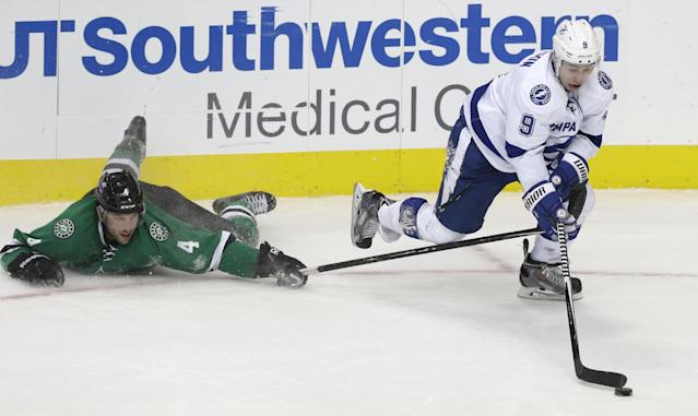 Tampa Bay Lightning center Tyler Johnson (9) takes control of the puck against Dallas Stars defenseman Jason Demers (4) during the third period of an NHL hockey game Thursday, Feb. 5, 2015, in Dallas. The Lightning won 5-3. (AP Photo/LM Otero)
