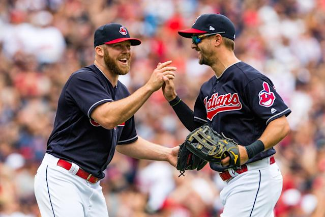Closer Cody Allen (left) celebrates with left fielder Lonnie Chisenhall, who made the final catch to defeat Detroit Tigers. (Getty Images)