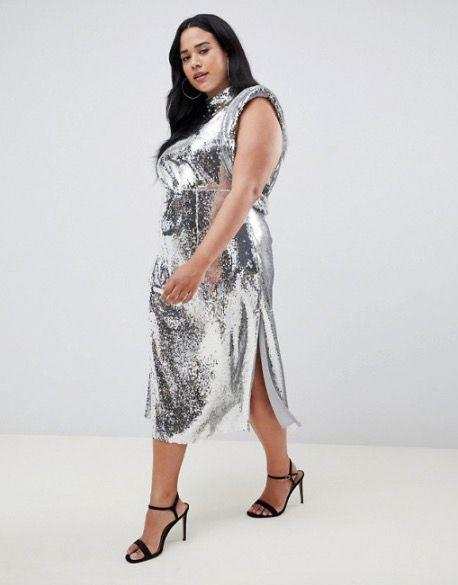 "<p><a rel=""nofollow"" href=""https://www.asos.com/asos-curve/asos-design-curve-high-neck-drape-armhole-midi-dress-in-all-over-sequin/prd/10382166?clr=silver&SearchQuery=&cid=9577&gridcolumn=1&gridrow=1&gridsize=4&pge=1&pgesize=72&totalstyles=2290"">Buy now</a> All Over Sequin Dress, £95</p>"