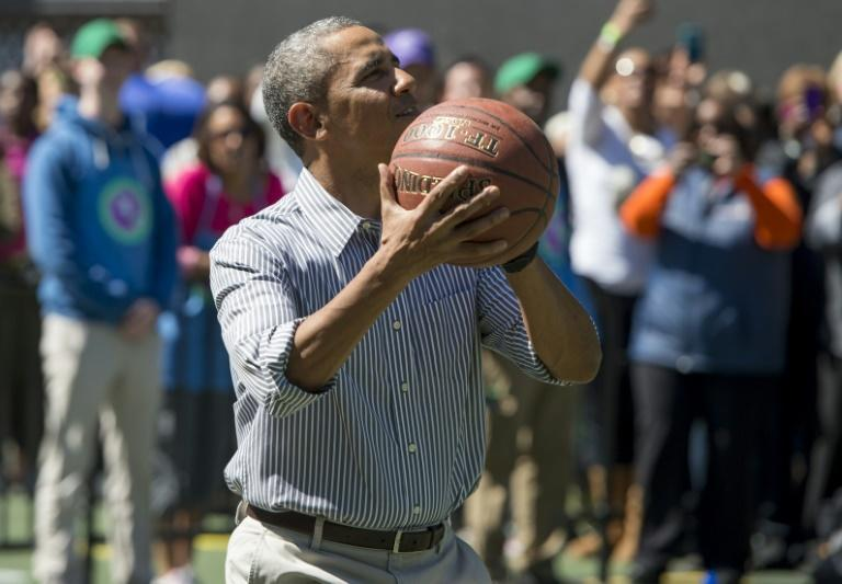 Then-president Barack Obama shoots a basketball at the White House in April 2014