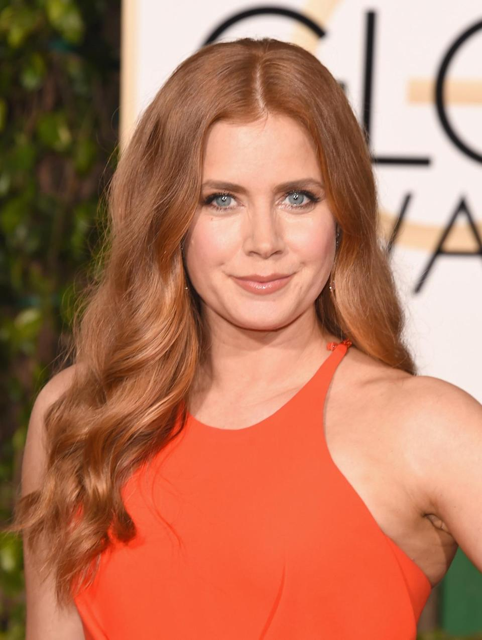 <p>The normally porcelain-skinned actress had a luminous glow about her tonight. Might she had some help from Jergens? <i>(Photo: Getty Images)</i></p>