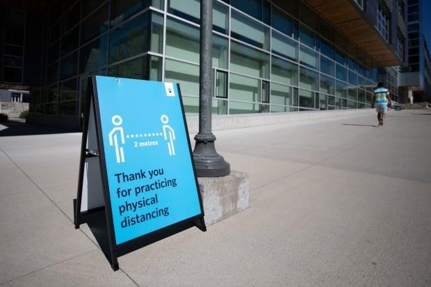 A sign on UBC campus reminding students to practise physical distancing. Partying students received over $5,000 in fines for violating COVID-19 health orders on the weekend.