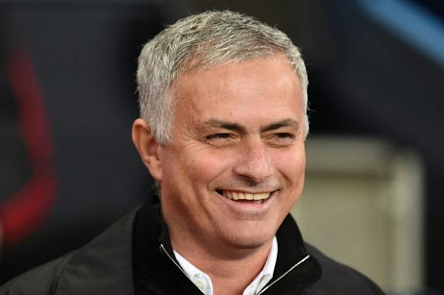 Happy and 'humble': New Tottenham manager Jose Mourinho says he has learned from his mistakes at Manchester United (AFP Photo/Oli SCARFF )