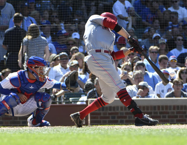 Cincinnati Reds' Joey Votto (19) hits an RBI single against the Chicago Cubs during the sixth inning of a baseball game Saturday, July 7, 2018, in Chicago. (AP Photo/David Banks)