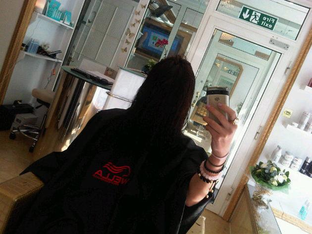 Celebrity photos: Imogen Thomas got a bit bored at the hairdressers this week, and decided to tweet this image of herself with her hair over her face. No, we don't know why either.