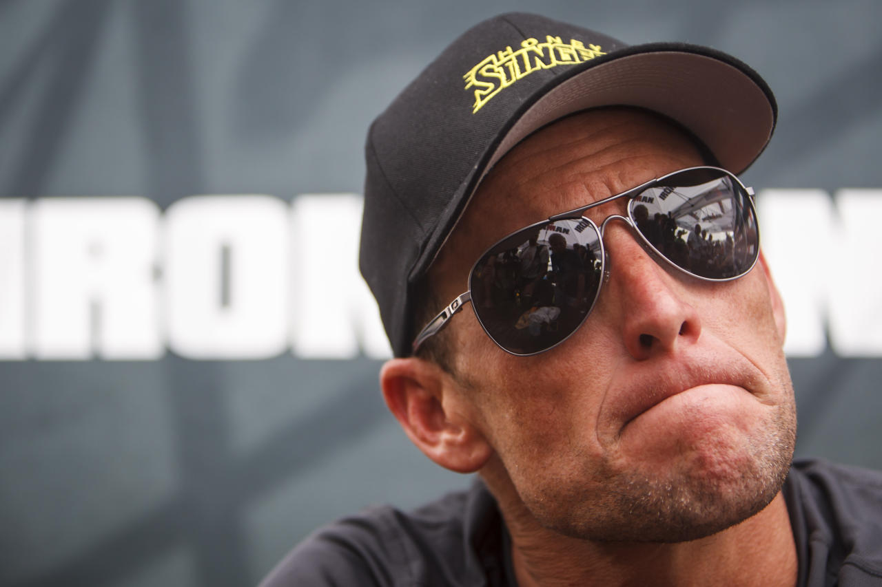 FILE - This April 1, 2012 file photo shows seven-time Tour de France champion Lance Armstrong grimacing during a news conference after the Memorial Hermann Ironman 70.3 Texas triathlon in Galveston, Texas. A federal judge in Austin, Texas, has thrown out Lance Armstrong's lawsuit against the U.S. Anti-Doping Agency, an attempt to stop the drug case against the seven-time Tour de France winner. (AP Photo/Houston Chronicle, Michael Paulsen, File ) MANDATORY CREDIT