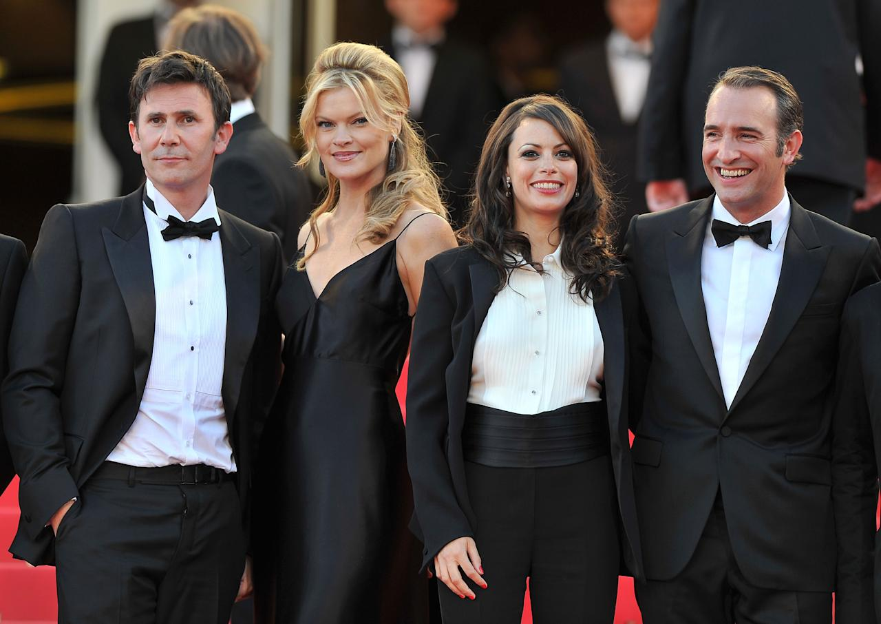 """CANNES, FRANCE - MAY 15:  (L-R) Director Michel Hazanavicius, actors Missy Pyle, Berenice Bejo and Jean Dujardin attend """"The Artist"""" premiere at the Palais des Festivals during the 64th Annual Cannes Film Festival on May 15, 2011 in Cannes, France.  (Photo by Pascal Le Segretain/Getty Images)"""