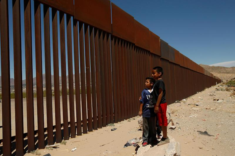 Children stand by a new section of the border wall on the U.S.-Mexico border in this picture taken from Anapra neighborhood in Ciudad Juarez, Mexico May 3, 2018: Reuters