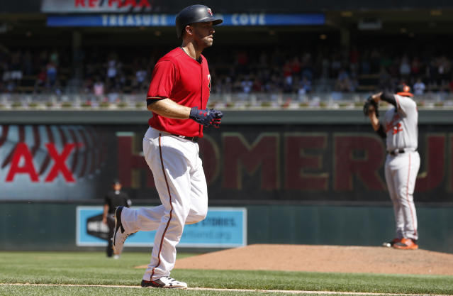 Minnesota Twins' Brian Dozier, jogs home on a three-run home run off Baltimore Orioles pitcher Ryan Meisinger, right, in the sixth inning of a baseball game Sunday, July 8, 2018, in Minneapolis. (AP Photo/Jim Mone)
