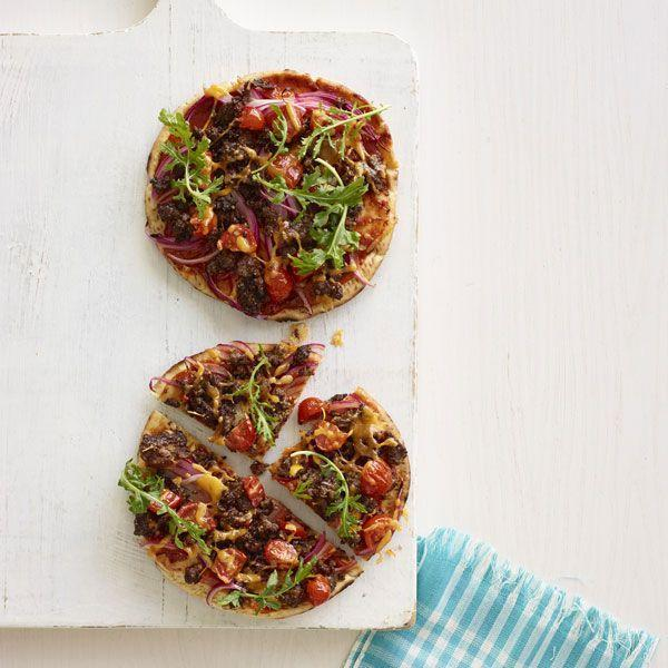 "<p>These pizzas are made on pita bread, so you can make them quickly on a weeknight without futzing with pizza dough. </p><p><a href=""https://www.goodhousekeeping.com/food-recipes/a16331/cheeseburger-flatbread-pizza-recipe-wdy0115/"" rel=""nofollow noopener"" target=""_blank"" data-ylk=""slk:Get the recipe for Cheeseburger Flatbread Pizza »"" class=""link rapid-noclick-resp""><em>Get the recipe for Cheeseburger Flatbread Pizza »</em></a></p>"