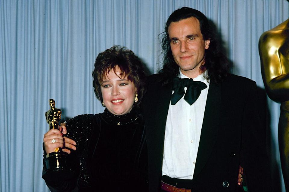 <p>Kathy Bates celebrated her Best Actress win with Daniel Day-Lewis, who presented her with the award. </p>