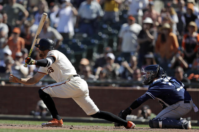 San Francisco Giants' Hunter Pence, left, follows through on a bases-loaded walkoff double against the San Diego Padres during the eleventh inning of a baseball game Sunday, June 24, 2018, in San Francisco. (AP Photo/Marcio Jose Sanchez)