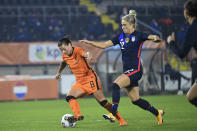 Netherlands' Sherida Spitse, left, and United States Kristie Mewis vie for the ball during the international friendly women's soccer match between The Netherlands and the US at the Rat Verlegh stadium in Breda, southern Netherlands, Friday Nov. 27, 2020. (Piroschka van de Wouw/Pool via AP)