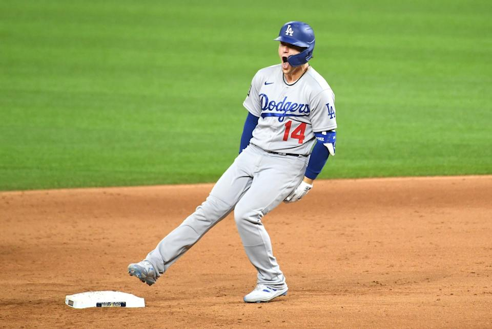 Dodgers second baseman Kiké Hernández celebrates after hitting a two-run double in the sixth inning.