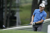 Mackenzie Hughes, of Canada, watches his tee shot on the 18th hole during the third round of the Travelers Championship golf tournament at TPC River Highlands, Saturday, June 27, 2020, in Cromwell, Conn. (AP Photo/Frank Franklin II)
