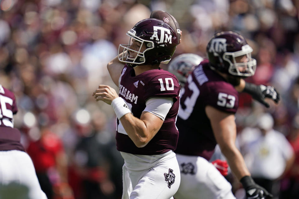 Texas A&M quarterback Zach Calzada (10) pass down field against New Mexico during the first half of an NCAA college football game on Saturday, Sept. 18, 2021, in College Station, Texas. (AP Photo/Sam Craft)
