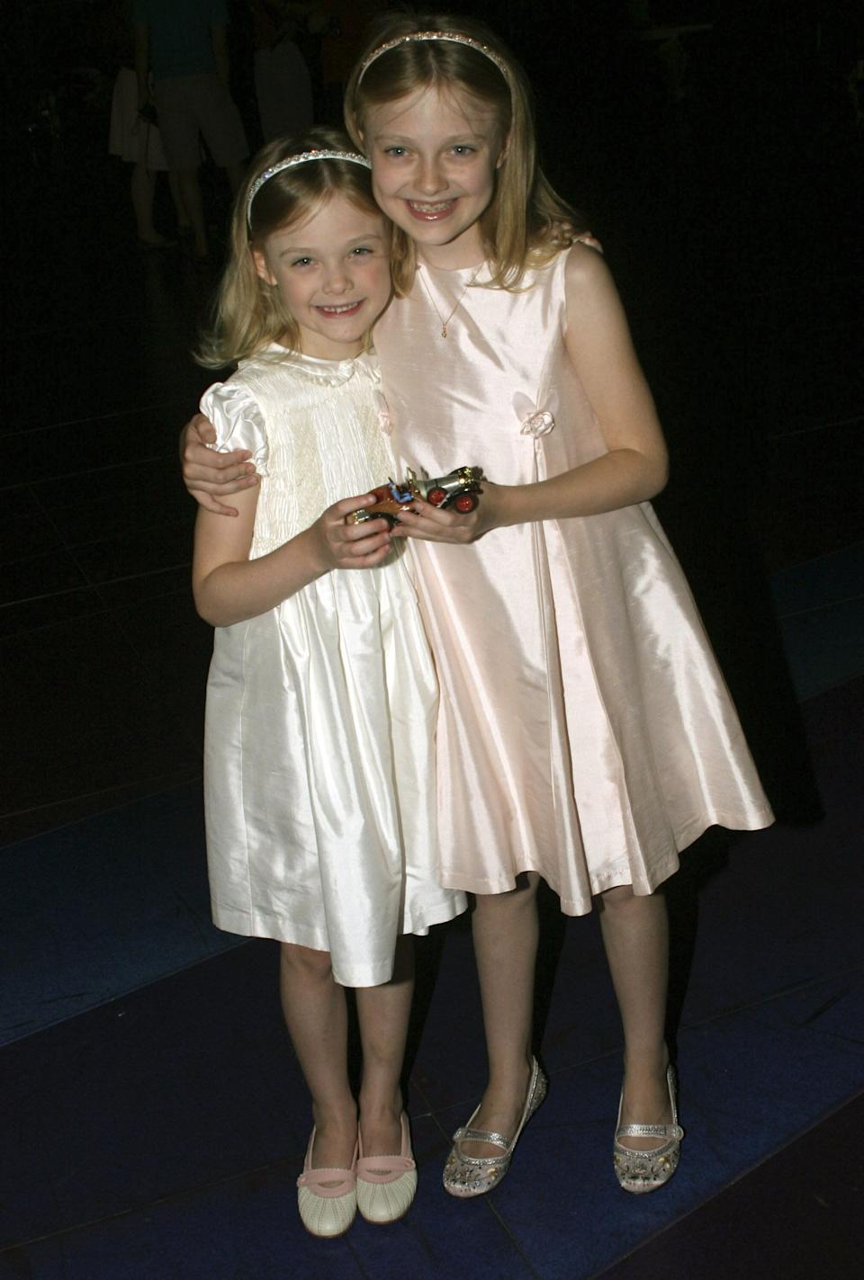 "The Fanning sisters attend ""Chitty Chitty Bang Bang"" on Broadway at The Hilton Theater in New York."