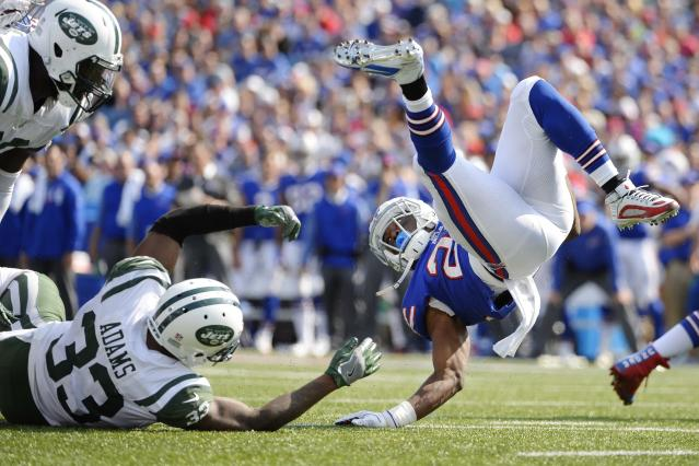 <p>Buffalo Bills running back LeSean McCoy (25) is tackled by New York Jets' Jamal Adams (33) as Muhammad Wilkerson (96) watches during the second half of an NFL football game Sunday, Sept. 10, 2017, in Orchard Park, N.Y. (AP Photo/Adrian Kraus) </p>