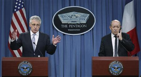 U.S. Secretary of Defense Hagel and French Minister of Defense Le Drian conduct a joint news conference after their meeting at the Pentagon in Washington