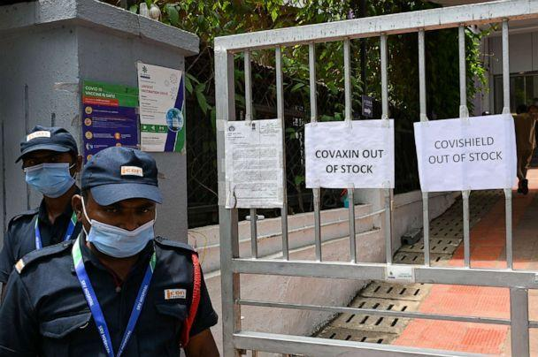 PHOTO: Security guards stand next to signs announcing that vaccines are out of stock outside a COVID-19 coronavirus vaccination center closed for three days due to shortage of vaccine supplies, in Mumbai on April 30, 2021. (Punit Paranjpe/AFP via Getty Images, FILE)