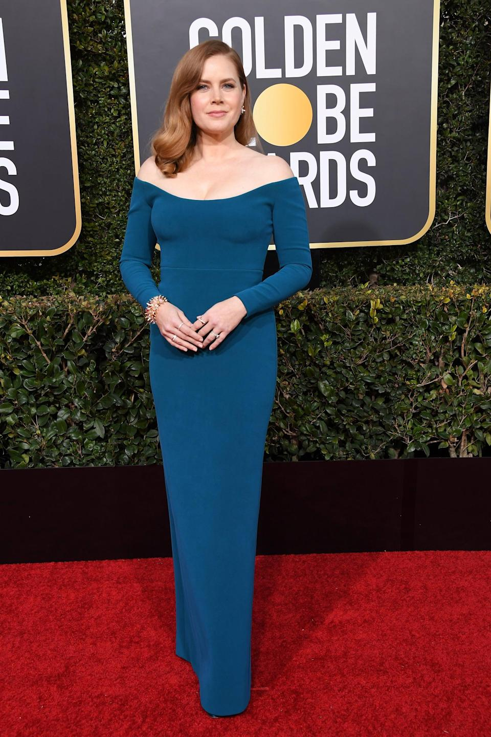 <p>Wearing a Calvin Klein by Appointment dress with Cartier jewels.</p>