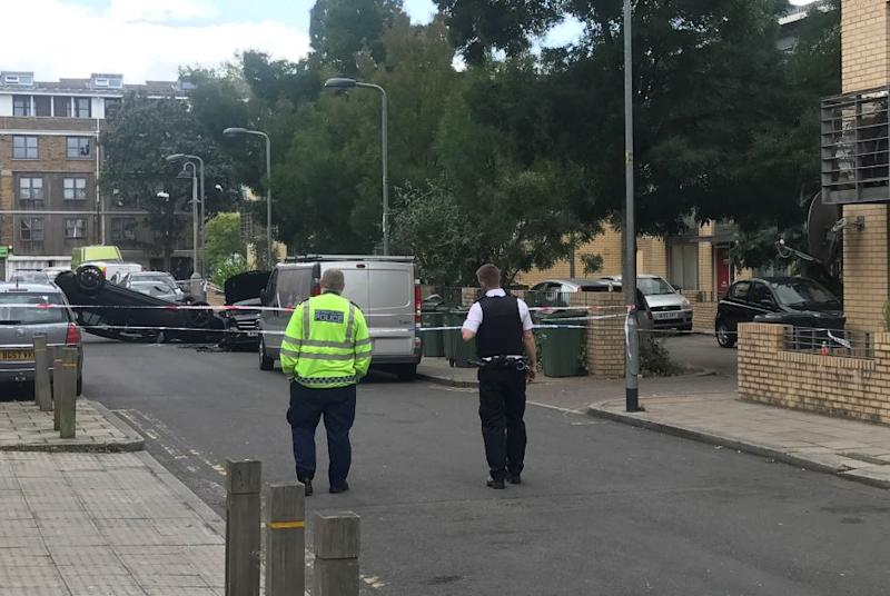 A flipped over car was found near where the man was stabbed (Picture: SWNS)