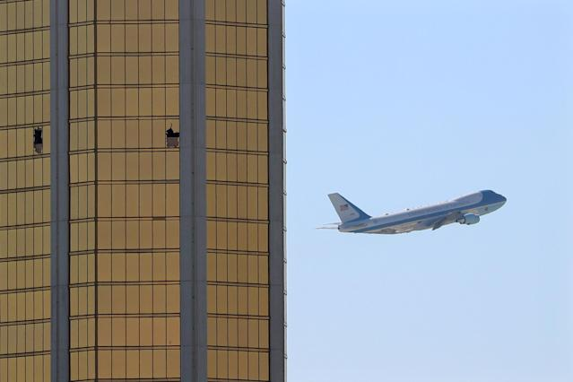Air Force One departs Las Vegas past the broken windows on the Mandalay Bay hotel, where shooter Stephen Paddock conducted his mass shooting. (REUTERS)