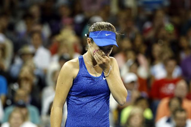 CiCi Bellis, of the United States, reacts after losing a point to Zarina Diyas, of Kazakhstan, during the second round of the U.S. Open tennis tournament Thursday, Aug. 28, 2014, in New York. (AP Photo/Jason DeCrow)