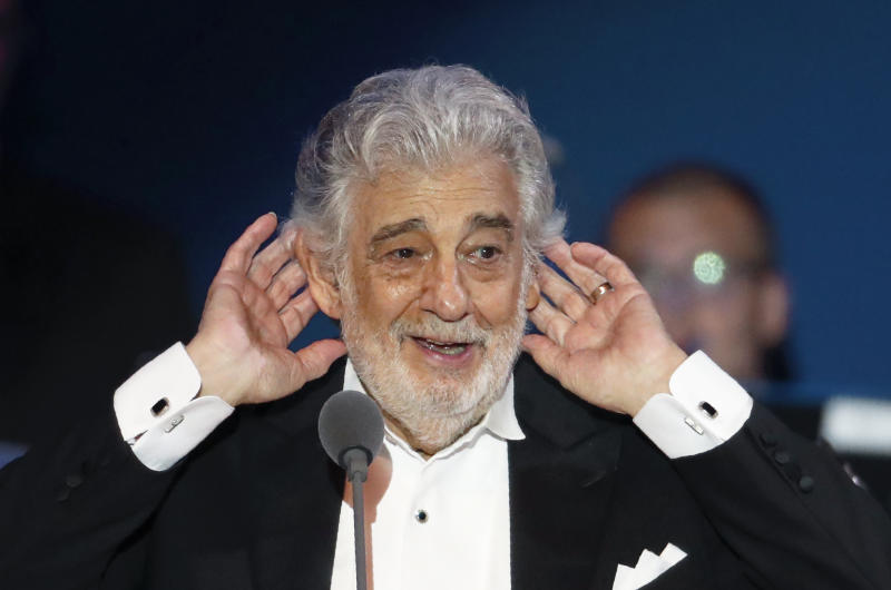 Opera star Placido Domingo listens to applause at the end of a concert in Szeged, Hungary, Wednesday, Aug. 28, 2019. Domingo continued his calendar of European engagements unabated despite allegations of sexual harassment, appearing Wednesday at a concert in southern Hungary to inaugurate a sports complex for a local Catholic diocese.(AP Photo/Laszlo Balogh)
