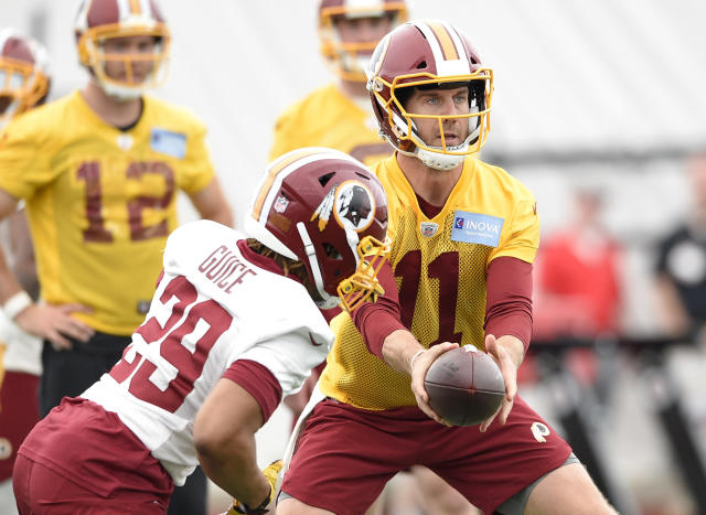 Quarterback Alex Smith (11) won't be handing off to running back Derrius Guice this season after the running back suffered a season-ending knee injury on Thursday in a preseason game. (AP)
